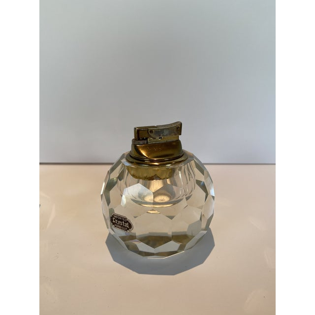 Vintage Crystal Table Lighter and Ashtray. Geometric, heavy cut crystal. Lighter has a removable brass mechanism that...