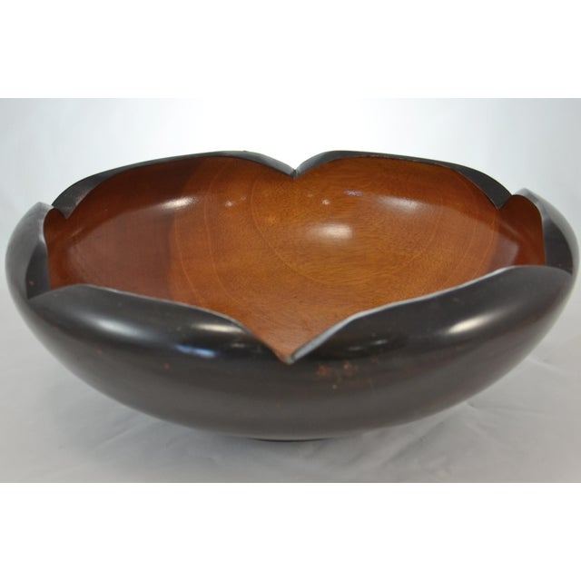 Large vintage mid century two-tone wood bowl with rolled and scalloped edge, black lacquered exterior, and natural golden...