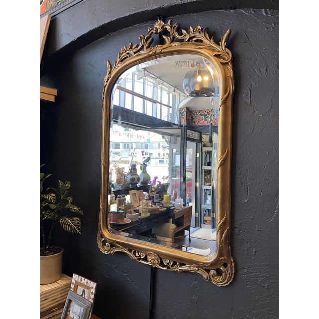 Stunning estate find! This antique gold leaf mirror brings stately romance to your entry way. Beautiful, circa 1920s. French.