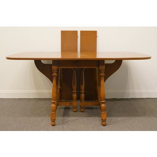 "20th Century Early American Ethan Allen Heirloom Nutmeg Maple Colonial 82"" Butterfly Drop-Leaf Dining Table Preview"