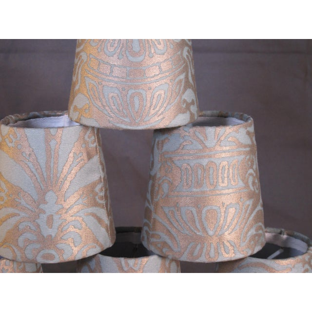A set of 6 clip top chandelier shades, handmade with Fortuny's iconic hand-printed fabric in the Campanelle pattern.