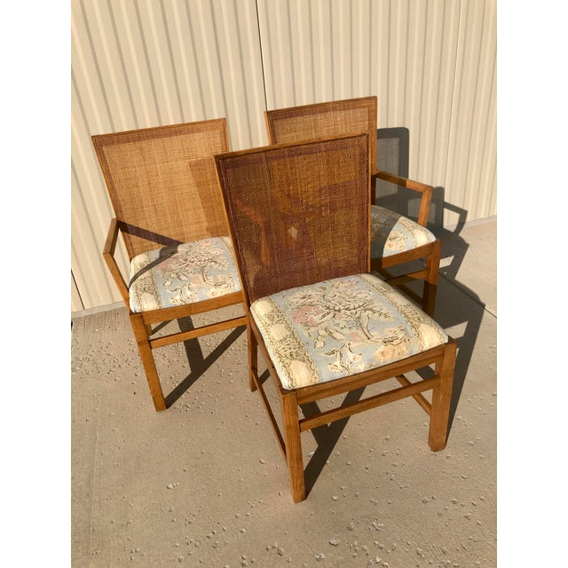 Three Mid-Century dining chairs styled after the Michael Taylor for Baker Furniture collection, with two arm chairs and...