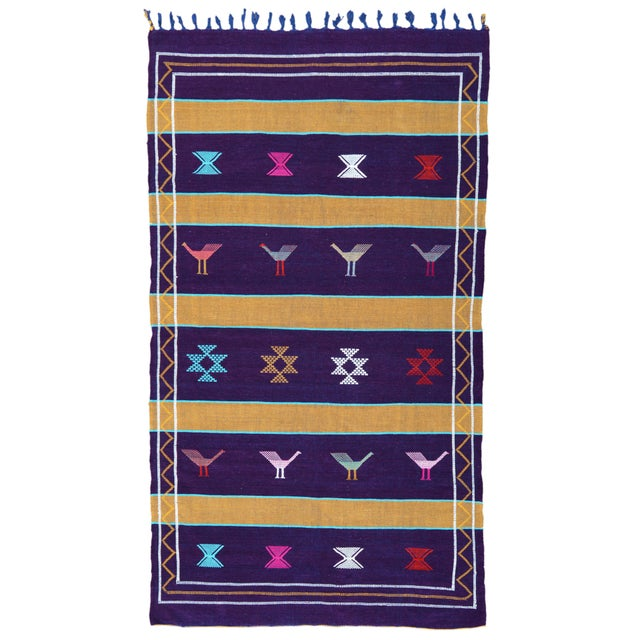 Cactus silk rug handwoven by the Berber tribe in the Atlas Mountains of Morocco. Features an intricate pattern of colorful...