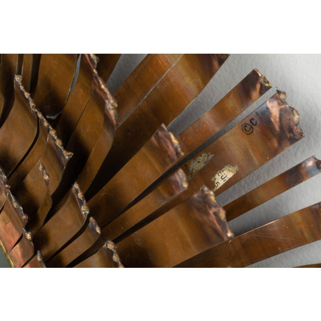 A rare brutalist style eyelash mirror wall sculpture by Curtis Jere, hand-crafted of four concentric layers of patinated...