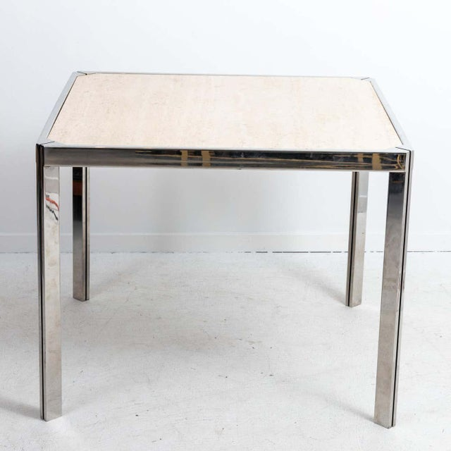 Travertine and nickel dining or game table in the manner of Willy Rizzo, circa 1970s. Made in France. Polished nickel...