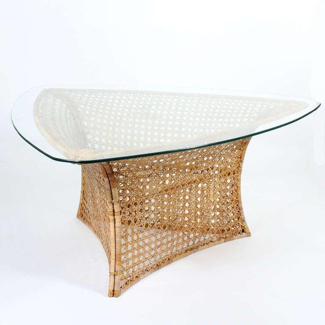 This is an amazing Mid-Century Modern dining or center table, by Danny Ho Fong, with a triangular glass top, the base made...