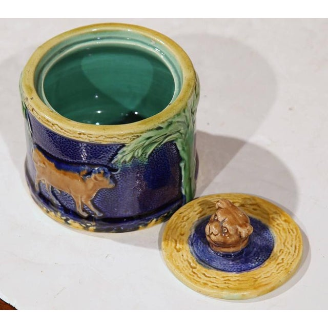 """This richly painted Majolica """"bonbonniere"""" was sculpted in France, circa 1880. The ceramic sugar dish features a small,..."""