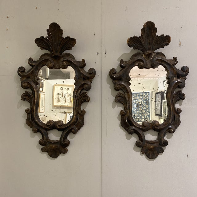 Pair of wooden shield mirrors. Great distressing to finish for an antique feel.