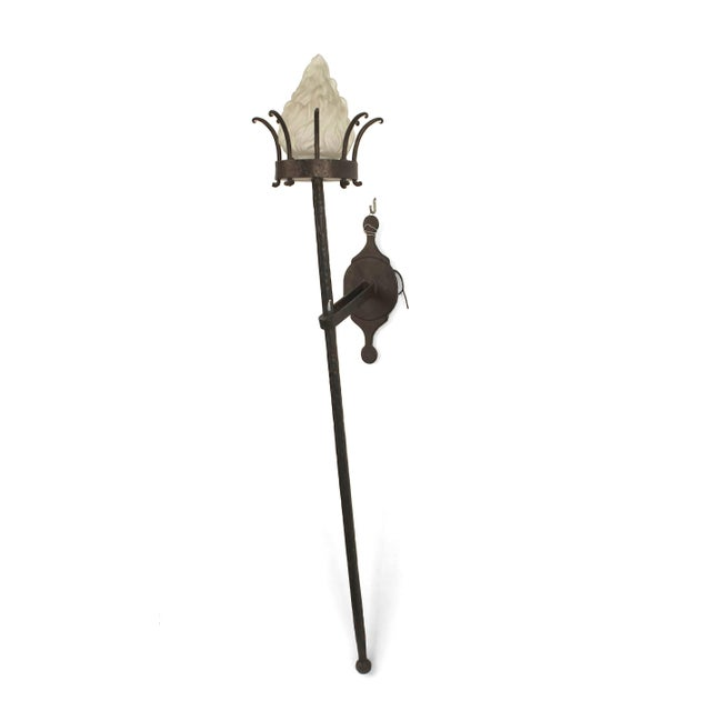 Two pairs of Italian Renaissance style (20th century) wrought iron large wall brackets (sconces) with a long pole ending...