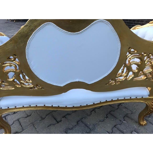 A unique sofa/settee/loveseat in French Louis XVI style, just arrived in our warehouse! Recently re-gild handmade frame...