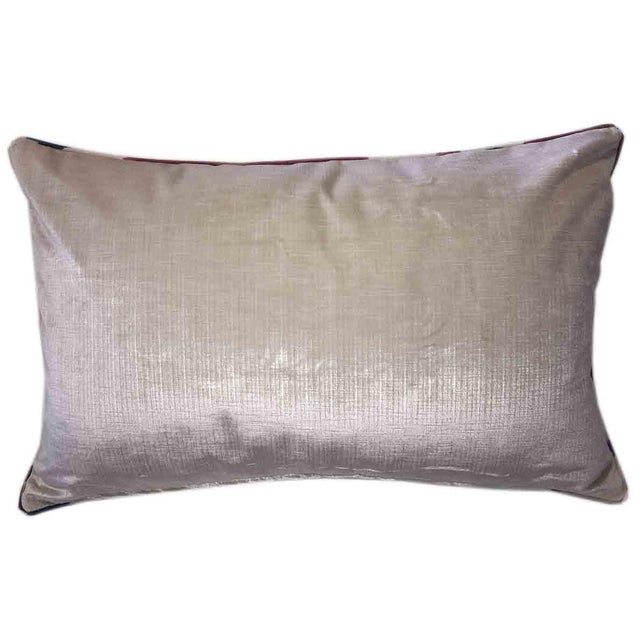 """Offered is a Brunschwig & Fils Samarkand ikat lumbar pillow in cotton and linen. Size: 27.5"""" x 17.5"""" with a solid cream..."""