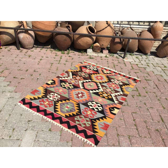 This beautiful, vintage, handwoven Kilim is approximately 60 years old. It is handmade of very fine quality, hand-spun...