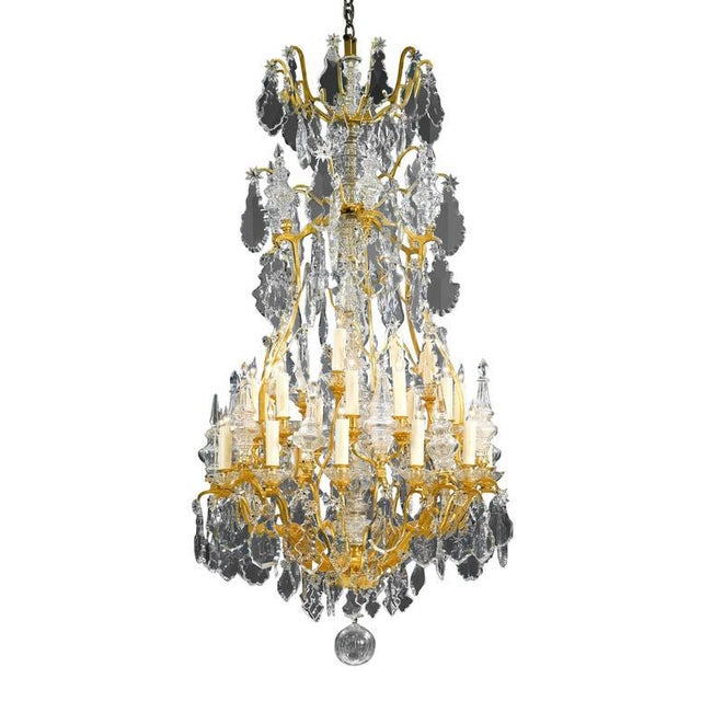 This Baccarat crystal and doré bronze chandelier is a grand sight to behold. Hundreds of beautifully designed oversized,...