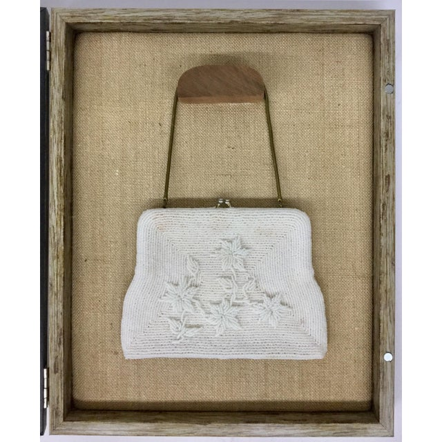 Not only will this antique purse look great hanging in your room, but when you are ready to go out for an evening on the...
