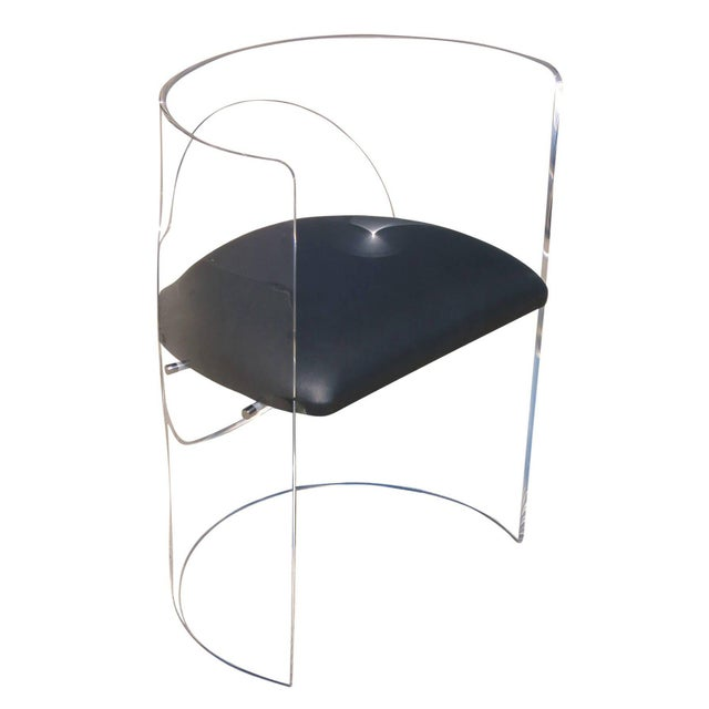 This Mid-Century style armchair by the famed designer Charles Hollis Jones features a wraparound Lucite frames that...