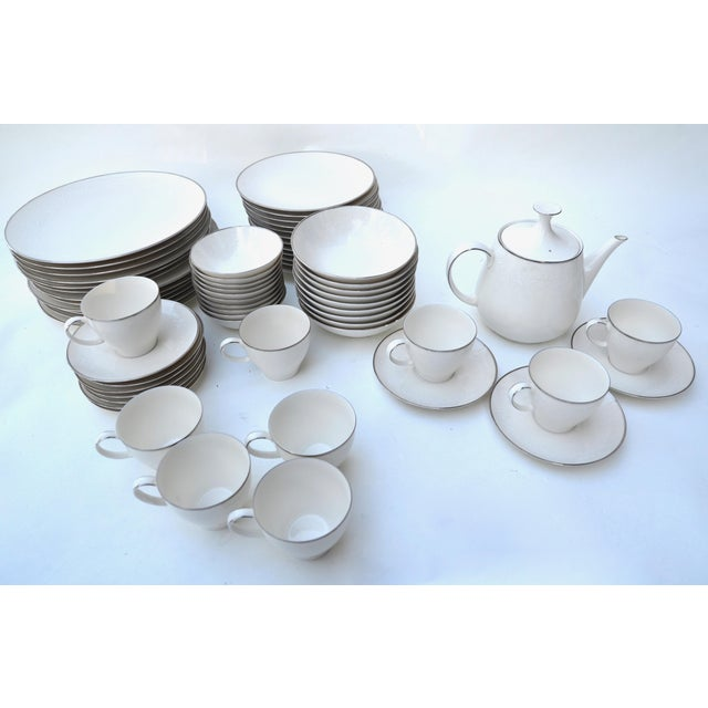 Noritake Lorelei fine china 80 piece set, produced from 1965 to 1979 featuring a delicate white on white floral pattern...