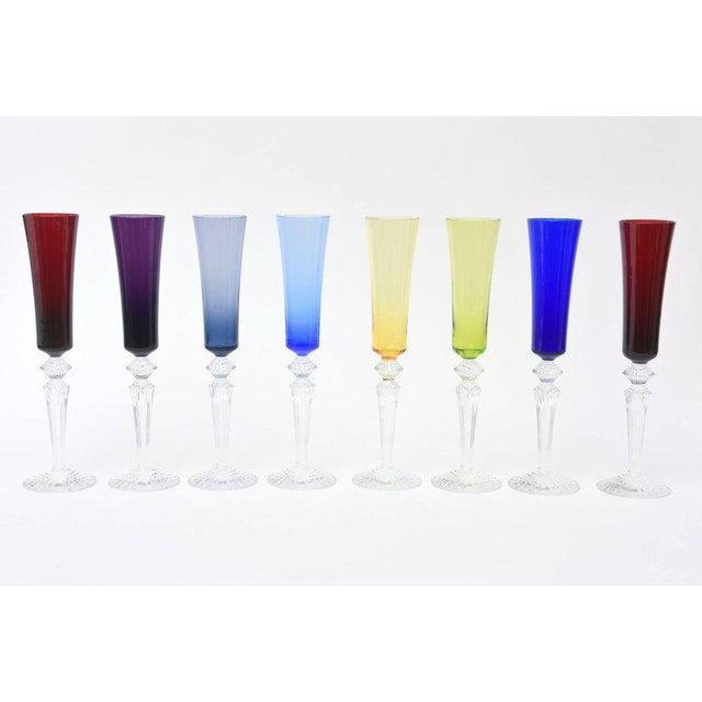 This collection of eight modern baccarat signed champagne flutes called mille nuit flutisssimo make a gorgeous table...