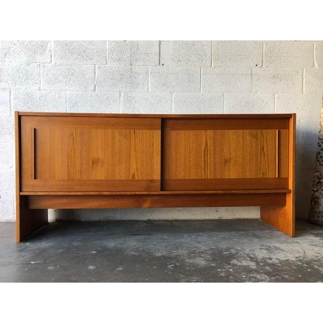 A vintage, Mid Century Modern Danish teak Size Table by Gangso Mobler Denmark. C 1980s. Featuring minimalist Danish Modern...