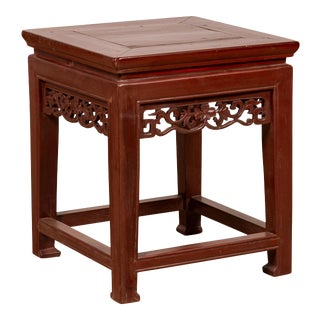 Antique Chinese Waisted Stool with Dark Red Patina and Foliage Hand Carved Apron For Sale