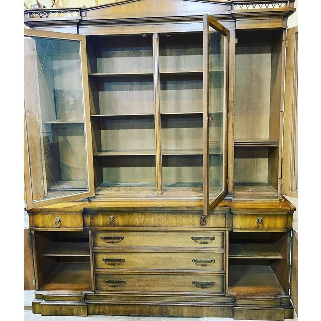 This piece has exceptional style with its brass accent fencing and knobs along top edge. Cool brass lions head drawer...