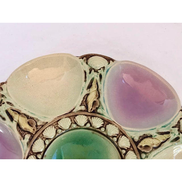 This is a rare pastel color for this Antique Late 19th Century Majolica Oyster Plate. It is attributed to Minton but does...