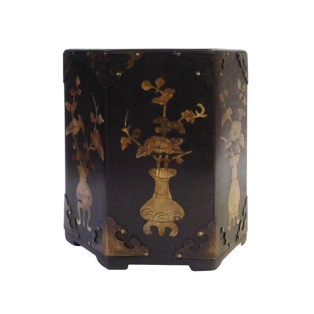 This is a decorative, traditional Chinese brush holder featuring a unique, hexagonal shape. It is made of wood with metal...