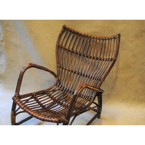 Beautiful early 20th century Italian rattan arm chair. Beautiful design, very comfortable. Would work great in a variety...