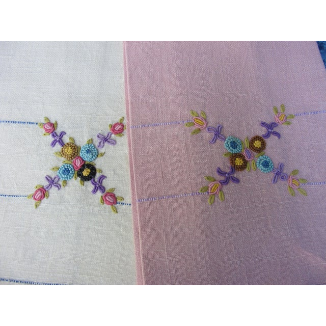A lovely pair of hand towels with a hand embroidered floral motif. Freshly starched and pressed.