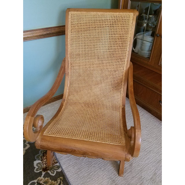 A wonderful, Plantation arm chair that is known as Planter's arm chair made for lounging. Very well constructed of solid...