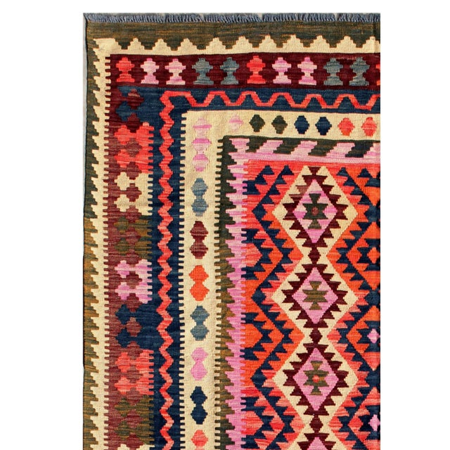 Amazing Turkish vintage Kilim with unique pattern! Truly one-of-a-kind. This flat-weave kilim rug is masterfully hand-...