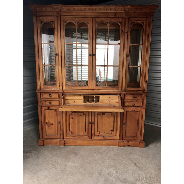 Stately Pinehurst Collection breakfront by Drexel. Details abound in this antique inspired piece. The distressed pine...
