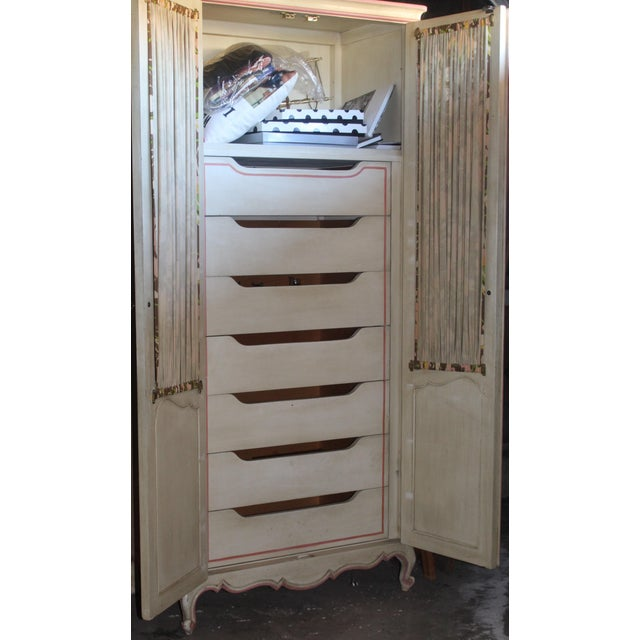This armoire is versatile. It could be for the bedroom, study, or even as a rich addition to a linen closet. Lots of...