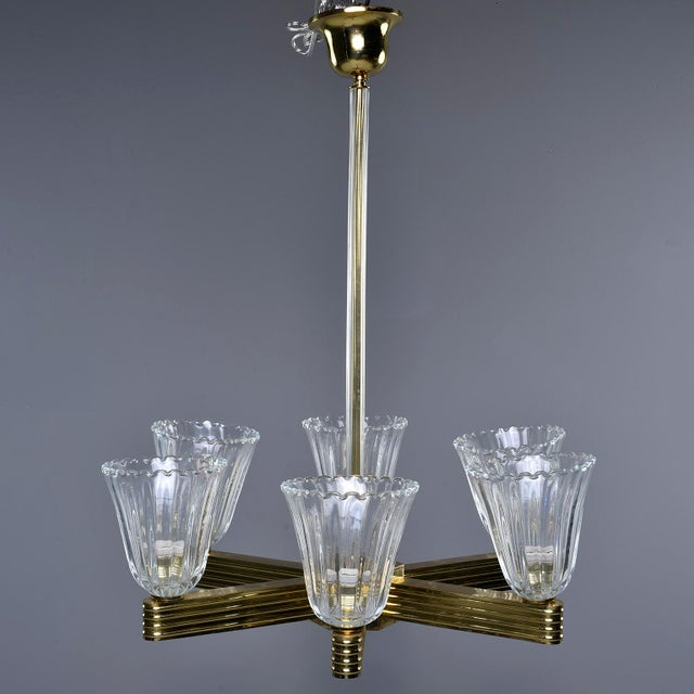 Circa 1930s pair of six light chandeliers attributed to Ercole Barovier and Toso feature brass ceiling canopy, glass...