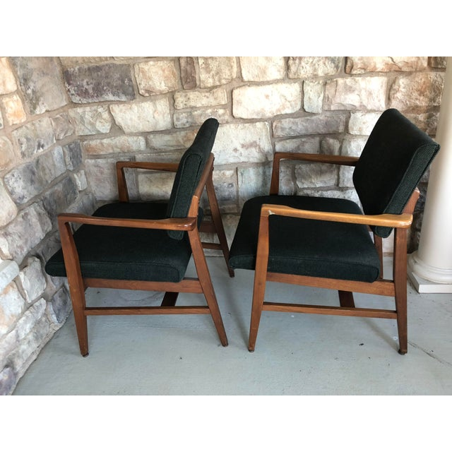VINTAGE ARM CHAIRS. Solid wood frames (assumed walnut) with dark deep green upholstery. Sturdy and clean. Nice foam on...
