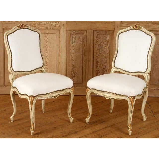 Labeled Jansen Hollywood Regency Pair Of Oversized Side or Desk Chairs in a Parcel Gilt Paint Finished from having clean...