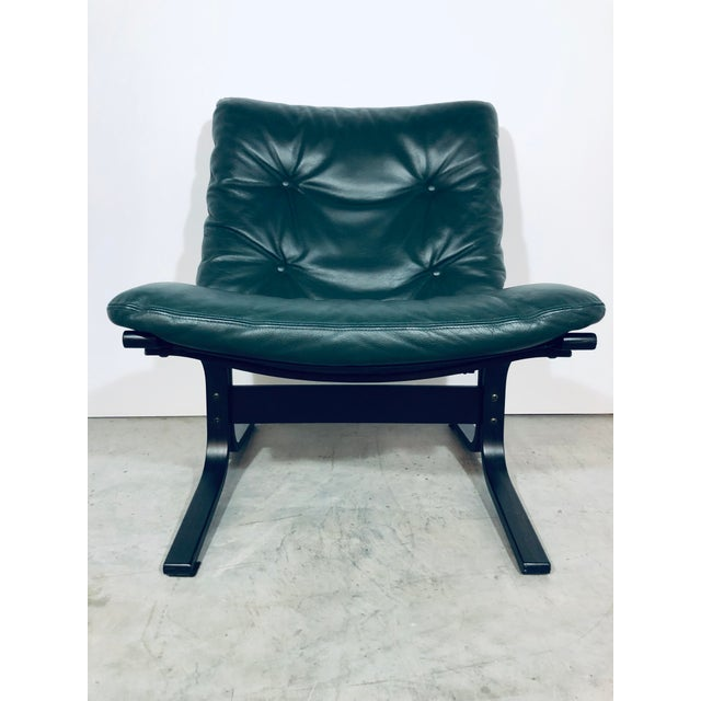Green leather Siesta chair by Ingmar Relling for Westnofa. 1970s.