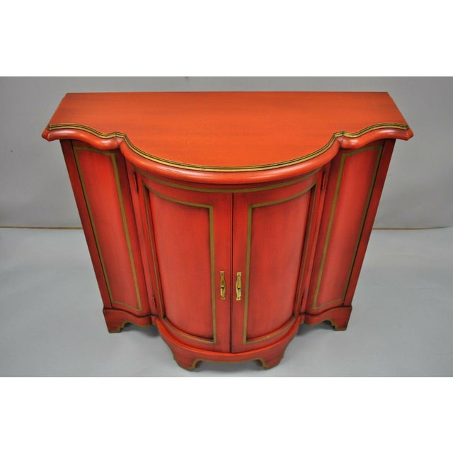 Vintage Red Lacquer Demilune Chinoiserie Georgian Style Cabinet by Medallion Limited. Item features red lacquer distress...