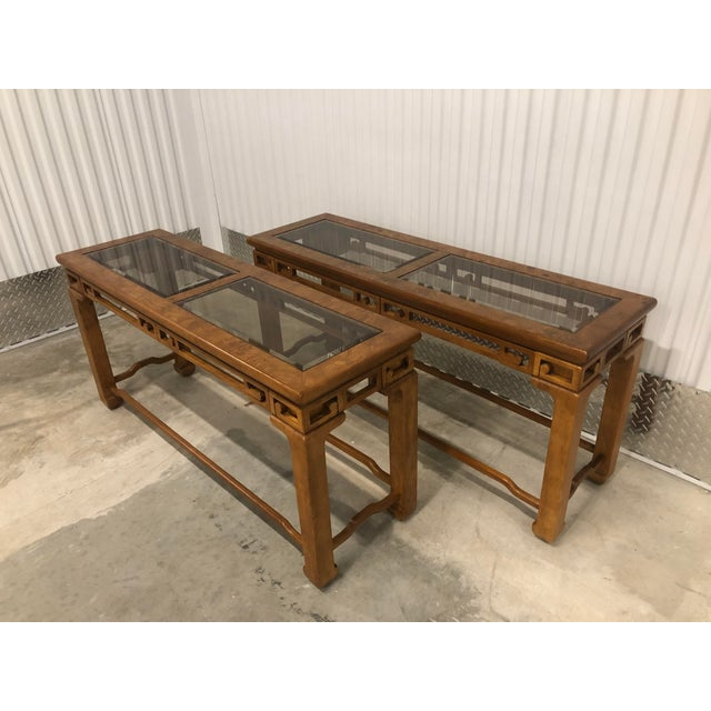 A pair of simple and elegant Chinese inspired hardwood true sofa tables constructed of solid wood with burlwood veneer...