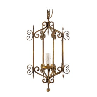 French Mid-20th Century Single Light Scrolled Iron Chandelier in Gold Bronze Hue For Sale