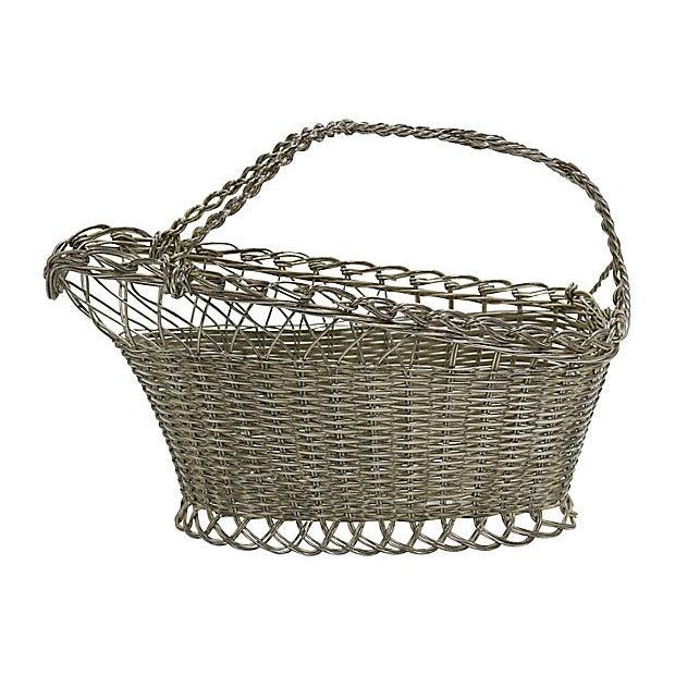 French silver-plate wine basket. No maker's mark. Light wear. Bottle not included.