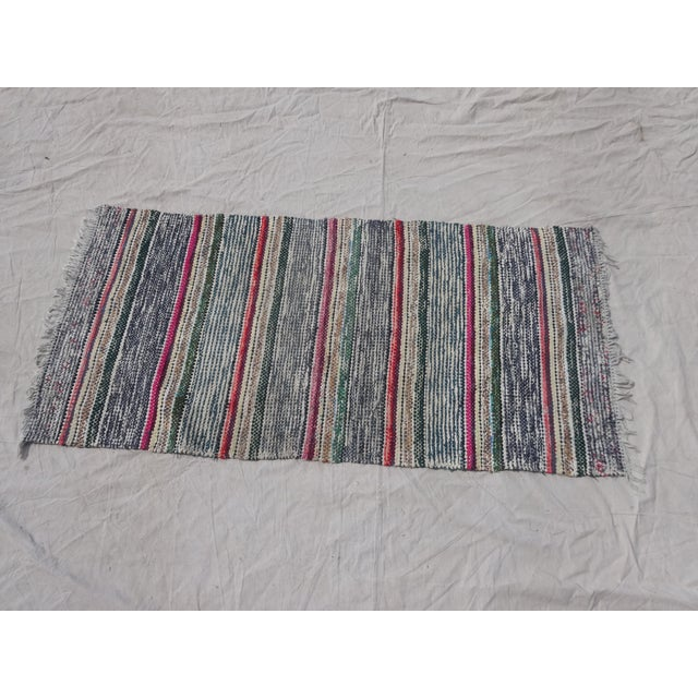 This is an antique, hand-woven Swedish rag rug.