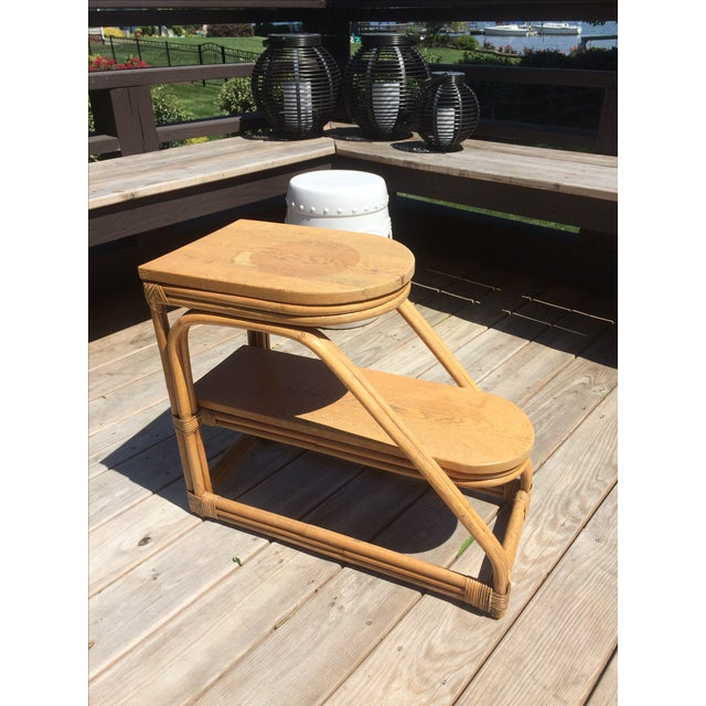 Rare vintage rattan side table with a two-tiered design that is typical of 1950's. Very boho chic! Adds a lot of funky...