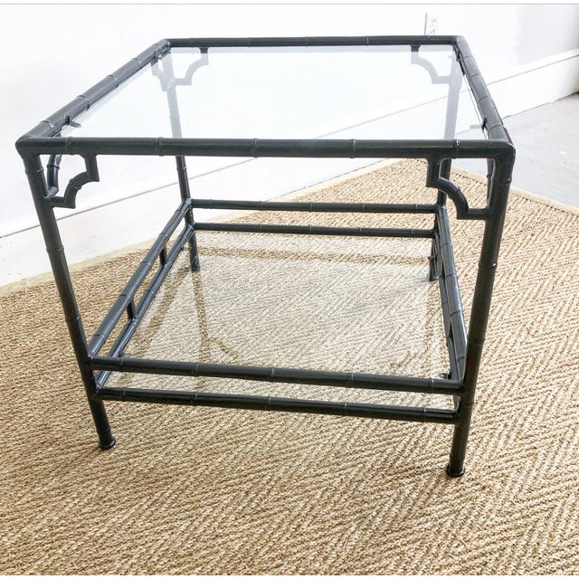 Vintage faux bamboo outdoor metal 2 tier side accent table with glass top inserts. From the 1960s this faux bamboo style...