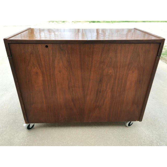 This is a Mid-Century Modern 1950's dry bar on rolling and locking casters. There are holes for 22 glasses of varying...