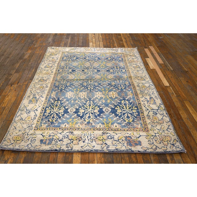 Antique Indian Agra, Cotton Rug with a blue background and beige border.