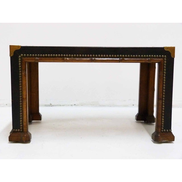 1960s, faux-bamboo, black leather top side table with nailhead and brass accents. By Drexel for the Et Cetera line....