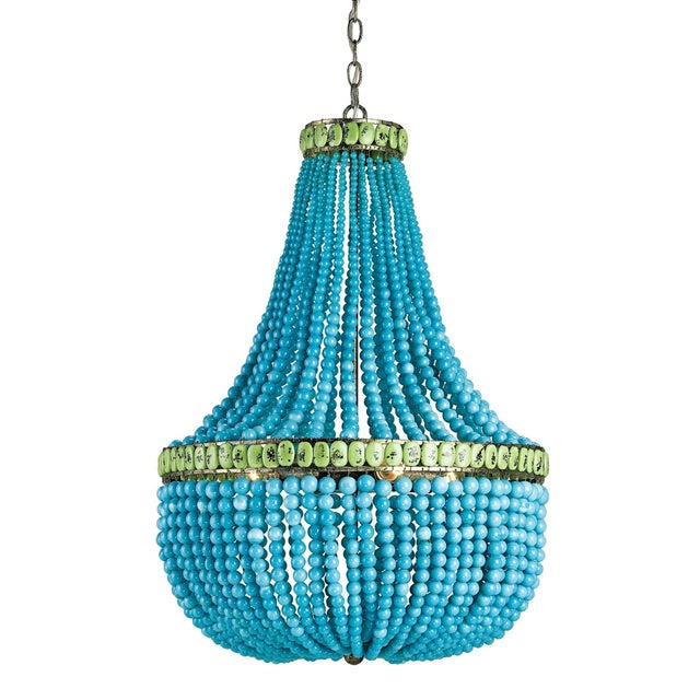 Boldly fusing a traditional form with unexpected materials, the Hedy Turquoise Chandelier is fitted with strands of...