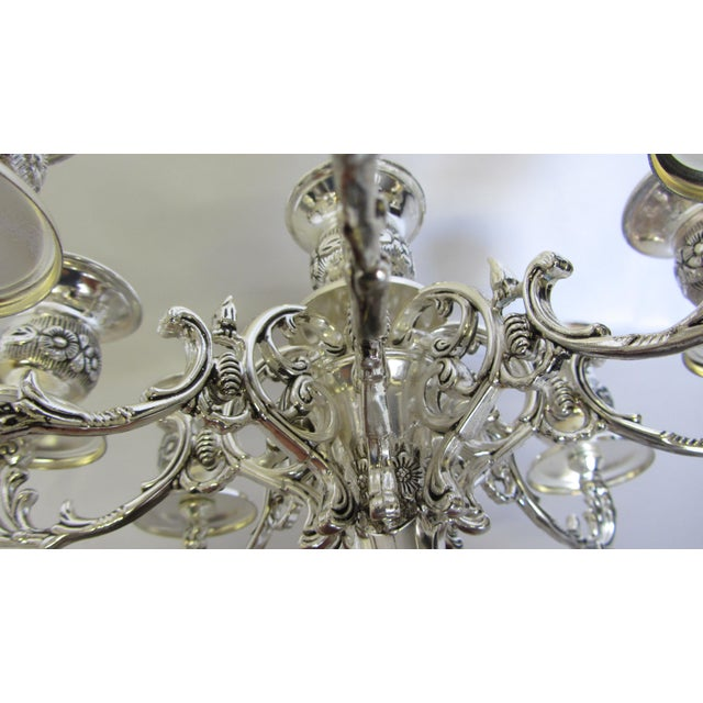 Pair of never used Godinger silver plate 9 arm candelabras featuring intricate floral and scroll acanthus leaf detail and...