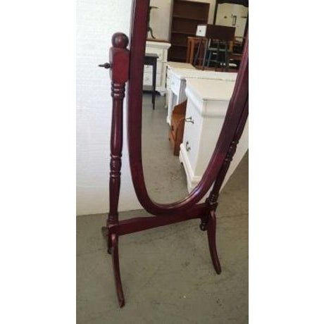 This wooden mirror works great. It's easements are W22, H52″. Cherry finish.