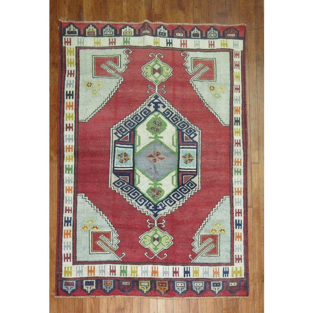 Colorful one of a kind hand-knotted Vintage Turkish Konya village Rug. circa 1940.
